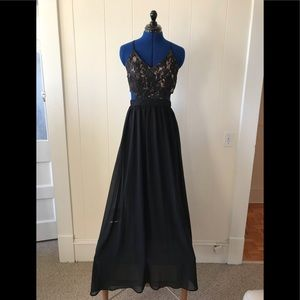Wowza! Black lace cutout dress with flowing skirt